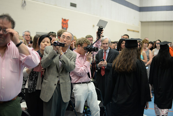 PAUL BILODEAU/Staff photo. Parents use their recording devices to document during Ipswich High School's graduation ceremony in the field house at the school.