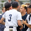 DAVID LE/Staff photo. Danvers captain Danny Lynch is mobbed by teammates after he crossed the plate following his second homer of the game. 6/9/16.