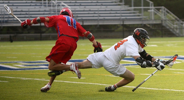 Beverly: During the North Division 2 playoff quarterfinal held at Endicott College on Saturday afternoon. Beverly beat Burlington 14-9. Beverly's Noah Kaplan, right, in action with Burlington's Jake Hanafin. Photo by Allegra Boverman