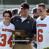 DAVID LE/Staff photo. Beverly senior captains Jordan Rawding (34) and Sam Traicoff (6) with head coach John Pynchon. 6/10/16.
