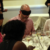 DAVID LE/Staff photo. Blindfolded diners enjoy and try and figure out what they are eating for one of their four courses. 6/8/16.