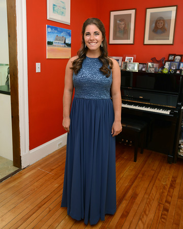 RYAN HUTTON/ Staff photo<br /> Beverly High senior Carly Blau is wearing a prom dress previously worn by her late friend Catherine Malatesta, who passed away from stage four cancer after wearing it herself. Blau is the fourth girl in their friend group to wear the dress to prom in Catherine's honor.