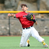 DAVID LE/Staff photo. North Andover senior shortstop Brian Varoutsos fires to first from his knees to try and throw out a Danvers baserunner. 6/9/16.