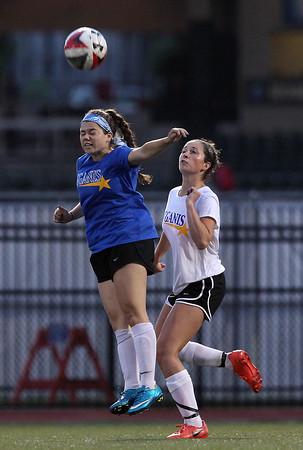 DAVID LE/Staff photo. Recent Salem High School grad Nicole Sadoway wins a header in front of recent Bishop Fenwick grad Ellen Fantozzi during the Agganis Girls Soccer game on Tuesday evening. 6/28/16.