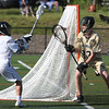 KEN YUSZKUS/Staff photo.     Marblehead's Drew Cioffi passes to a teammate from behind the net during the Northeast Metros at Marblehead boys lacrosse state tournament game.<br />      06/01/16