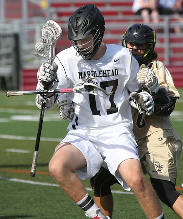KEN YUSZKUS/Staff photo.     Marblehead's Andy Clough watches an opponent's  stick fly up in front of him during the Northeast Metros at Marblehead boys lacrosse state tournament game.<br />      06/01/16