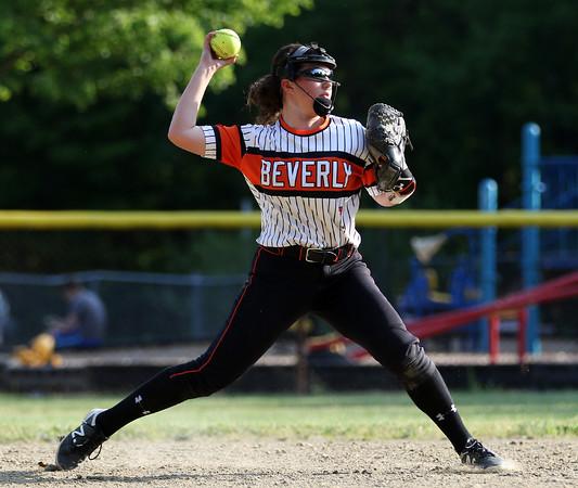 DAVID LE/Staff photo. Beverly shortstop Julia Pitman fires across the diamond to gun down a Peabody runner. 5/25/16.
