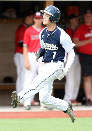 DAVID LE/Staff photo. Danvers senior captain Danny Lynch dances his way to the plate after launching a 400 ft home run to dead center field against North Andover in the D2 North semifinal on Thursday afternoon at Endicott College in Beverly. 6/9/16.