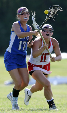DAVID LE/Staff photo. Masco senior Molly Gillespie (11) battles for a loose ball with Danvers senior Abigail Armstrong (17). 6/2/16.