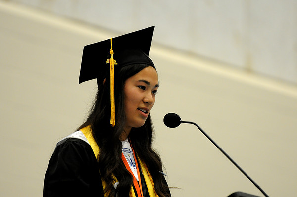 PAUL BILODEAU/Staff photo. Salutatorian Camille Devoe delivers her speech during Ipswich High School's graduation ceremony in the field house at the school.