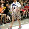 KEN YUSZKUS/Staff photo.      Nikki Erricola walks the runway at the Centerville School in Beverly. Fourth graders put on a fashion show to show off things they made out of recyclable materials.     06/15/16