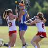 DAVID LE/Staff photo. Danvers senior captain Allie Zunick, center, loses the ball while trying to split Masco seniors Carly Tetreault (12) and Abby Reblin (6). 6/2/16.