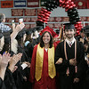 KEN YUSZKUS/Staff photo.   Class president Justyn Needel and Andrew Dalton lead the Marblehead High School graduates past the applauding faculty during the procession.     06/12/16