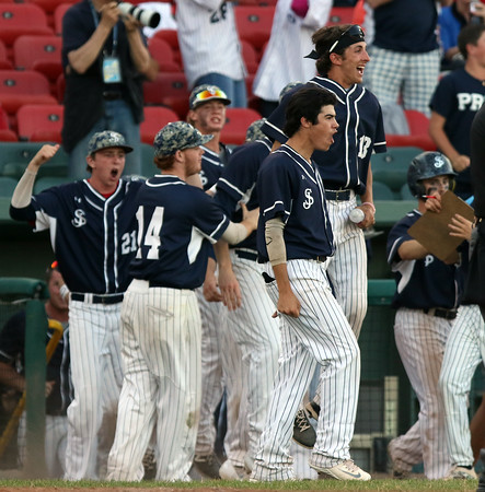 DAVID LE/Staff photo. The St. John's Prep bench reacts to junior Andrew Selima's second inning homer against Braintree. 6/16/16.