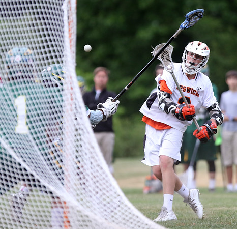DAVID LE/Staff photo. Ipswich sophomore attack Kevin Swenson rifles a shot on goal against North Reading in the D3 North quarterfinal on Friday afternoon. 6/3/16.