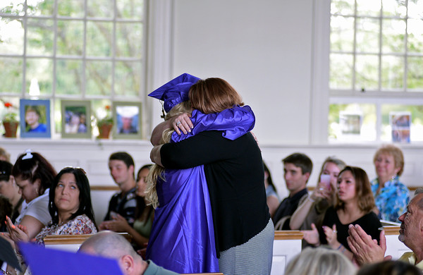 RYAN HUTTON/ Staff photo<br /> Northshore Recovery High School graduate Haley Conley hugs her mother after rushing down at the end of her graduation speech at the school's commencement ceremony at the Second Congregational Church in Beverly on Wednesday night.