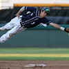 DAVID LE/Staff photo. St. John's Prep junior shortstop makes a diving effort but can't haul in a line drive up the middle. 6/16/16.