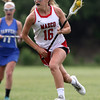 DAVID LE/Staff photo. Masco junior Grace Fahey sprints upfield against Danvers in the D1 North quarterfinals on Thursday afternoon. 6/2/16.