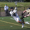 KEN YUSZKUS/Staff photo.     Marblehead's Drew Cioffi shoots and gets a goal as he falls during the Northeast Metros at Marblehead boys lacrosse state tournament game.<br />      06/01/16