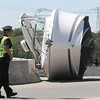 KEN YUSZKUS/Staff photo.     A boat lays on it's side on Bridge Street at the end of the bridge in Salem. The boat had fallen off a trailer while being transported.     06/01/16