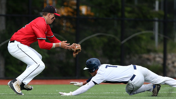 DAVID LE/Staff photo. North Andover third baseman Joseph Bramanti tags out Danvers senior Danny Lynch after he was caught in a rundown on a pickoff. 6/9/16.