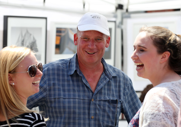 DAVID LE/Staff photo. Michael Miller, of E. Michael Miller Photography, chats with two customers at the annual Beverly Arts Fest on Saturday afternoon. 6/18/16.