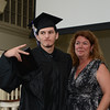 RYAN HUTTON/ Staff photo<br /> Northshore Recovery High School graduate Nick Iacono mugs for the cameras after getting his diploma from school director Michelle Lipinski at the school's commencement ceremony at the Second Congregational Church in Beverly on Wednesday night.