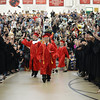 PAUL BILODEAU/Staff photo. The graduating class enters through a line of high school faculty during Salem High School's graduation ceremony in the high school's field house.