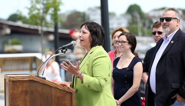 DAVID LE/Staff photo. Salem Mayor Kim Driscoll delivers remarks at the start of a ribbon cutting ceremony to dedicate the new Remond Park at the edge of the water at the base of the Salem-Beverly bridge on Monday morning. 6/20/16.
