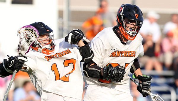 DAVID LE/Staff photo. Beverly junior Nick Dilusio, right, celebrates his second half goal with senior Hunter Spencer (12). 6/7/16.