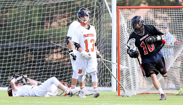 DAVID LE/Staff photo. Beverly goalie Kevin Morency, left, and defenseman Harrison Gallagher (13) can barely watch after Winchester senior Steven Fitzpatrick (18) scored. 6/10/16.
