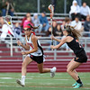 DAVID LE/Staff photo. Marblehead freshman Grace Arthur (3) streaks towards the net against Ipswich junior Chloe Rogers (7). 6/9/16.