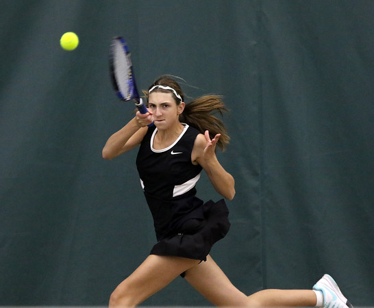 DAVID LE/Staff photo. Marblehead's Michelle Shub returns a volley against Concord-Carlisle 's Maggie Dorr in first singles play on Wednesday afternoon. 6/8/16.
