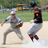 KEN YUSZKUS/Staff photo.      Beverly's Garrett Desmond is tagged out by Belmont's Dave Bailey trying to get back to 3rd during the Belmont at Beverly baseball state tournament game.     06/02/16
