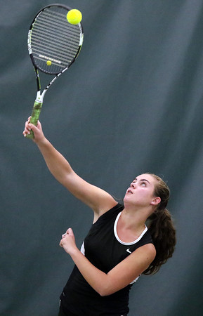DAVID LE/Staff photo. Marblehead's Julia Channing serves against Concord-Carlisle's Caroline Zeng at third singles play on Wednesday afternoon. 6/8/16.