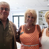 DAVID LE/Staff photo. Jack Walsh, of Dancing Sand, left, with Gina Flynn and Tammy Nickerson, of Eastern Bank, at a multi-chamber after hours networking event held at the recently renovated Ferncroft Country Club in Middleton on Thursday afternoon. 6/30/16.