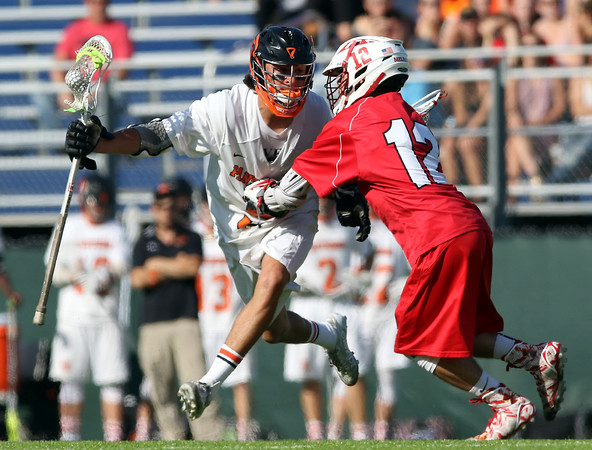 DAVID LE/Staff photo. Beverly junior Sam Abate tries to get past Melrose senior Brian Wagner (12) during the first half of play. 6/7/16.