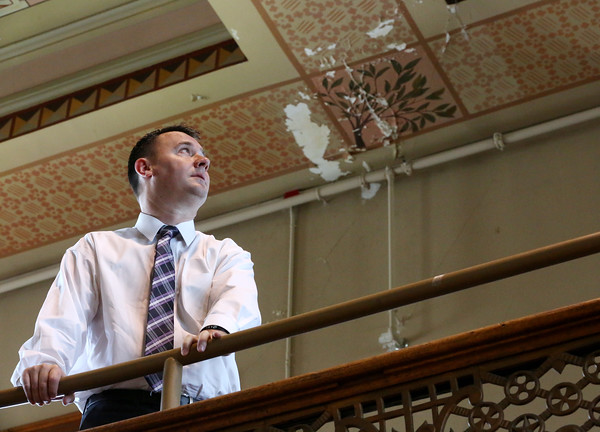 KEN YUSZKUS/Staff photo.   Peabody Mayor Bettencourt stands near one of the damaged areas of the ceiling at Peabody City Hall.     06/08/16