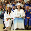 DAVID LE/Staff photo. Danvers High School graduates Kristen McCarthy, Aislinn McCarthy, and James McCarriston, smile while listening to Salutatorian Alexis Gilchrist's speech on Saturday afternoon. 6/11/16.