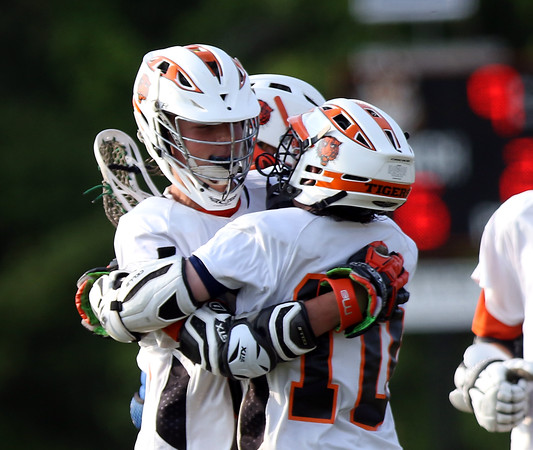 DAVID LE/Staff photo. Ipswich sophomore Kevin Swenson, left, gets a hug from sophomore Pat Gillis (10) after he scored one of his five goals against North Reading. 6/3/16.