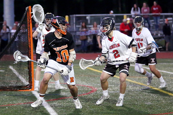HADLEY GREEN/ Staff photo<br /> Beverly's Chris Cole (10) moves near the goal while Hingham's Tommy Welch (2) plays defense at the Hingham v. Beverly boys lacrosse Division 2 state semifinals game at Norwell High School in Norwell, Massachusetts. 6/14/17