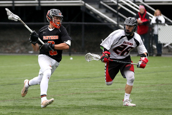 HADLEY GREEN/ Staff photo<br /> Beverly's Kyle Chouinard (2) runs up the field while Winchester's Peter Gallagher (28) defends him at the Winchester v. Beverly Division 2 North semifinals boys lacrosse game at Knowlton Field in Winchester. 6/06/17