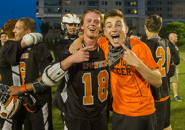 Ipswich's Duke Kriksceonaitis (18) poses with Mies Brengle as fans storm the field.