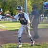 HADLEY GREEN/ Staff photo<br /> Danvers' Anthony Olszak (11) celebrates with teammate Matt Andreas (10) after scoring at the Danvers v. Woburn Division 2 North first round state tournament baseball game held at the Twi Field in Danvers. 6/01/17