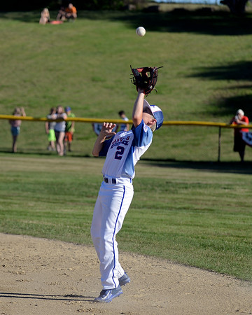 RYAN HUTTON/ Staff photo<br /> Danvers' Will McEnaney snags a fly ball for the out during the top of the second inning of Wednesday's game against Gloucester at Boudreau Field in Gloucester.