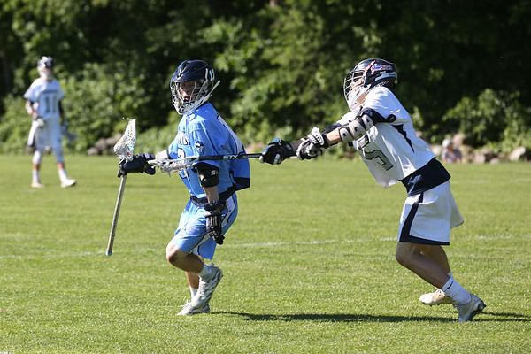 HADLEY GREEN/ Staff photo<br /> Triton's Rick Calvani (17) moves the ball while Hamilton-Wenham's Bryson Cala (5) defends him at the Hamilton-Wenham v. Triton Division 3 North semifinals boys lacrosse game at Pingree. 6/07/17