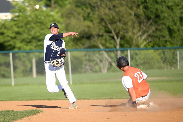 HADLEY GREEN/ Staff photo<br /> Danvers second baseman Tommy Mento (2) throws the ball to first after tagging Woburn's Darren Sanderson (21) out at the Danvers v. Woburn Division 2 North first round state tournament baseball game held at the Twi Field in Danvers. 6/01/17