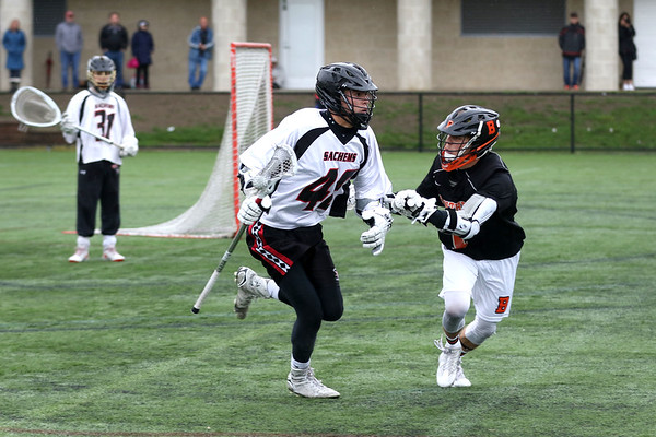 HADLEY GREEN/ Staff photo<br /> Beverly's Sean Demarkis (1) plays defense on Winchester's Brennan Clarke (46) at the Winchester v. Beverly Division 2 North semifinals boys lacrosse game at Knowlton Field in Winchester. 6/06/17
