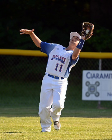 RYAN HUTTON/ Staff photo<br /> Danvers' Mike Piporiea snags a fly ball for the out during the top of the third inning of Wednesday's game against Gloucester at Boudreau Field in Gloucester.