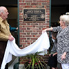 AMY SWEENEY/Staff photo. The Salem Fire Station on Loring Ave was dedicated to Joseph A. O'Keefe, Sr. on Saturday morning. O'Keefe's wife Camille  and brother Edward unveiled the plaque. Joseph O'Keefe, was a beloved city official who died in September 2015 and had a long and celebrated tenure on City Council. O'Keefe also served as state fire marshal from 1977 to 1992. <br /> June 17, 2017